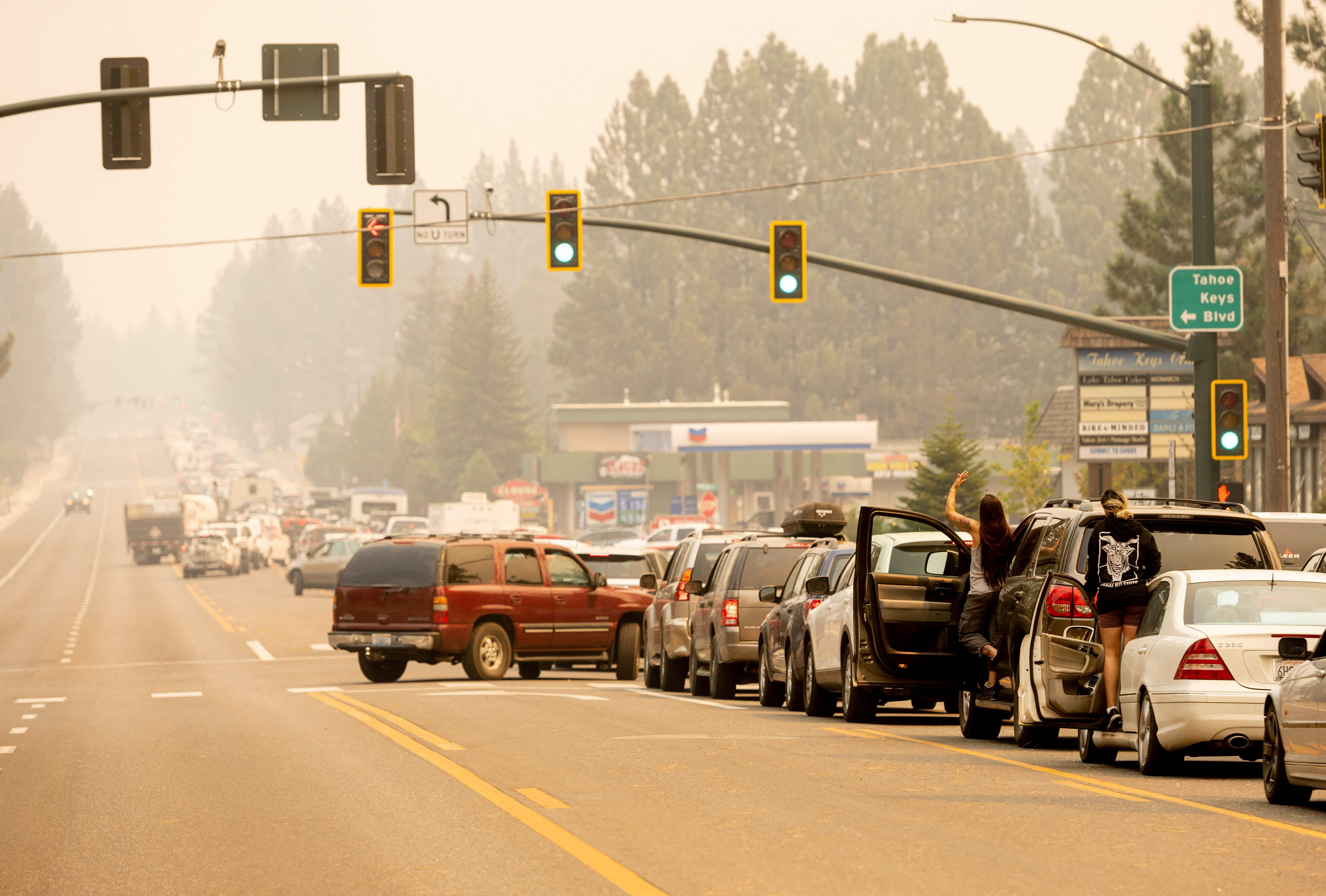 Residents are stuck in traffic Monday as they attempt to evacuate while the Caldor fire approaches South Lake Tahoe, Californ