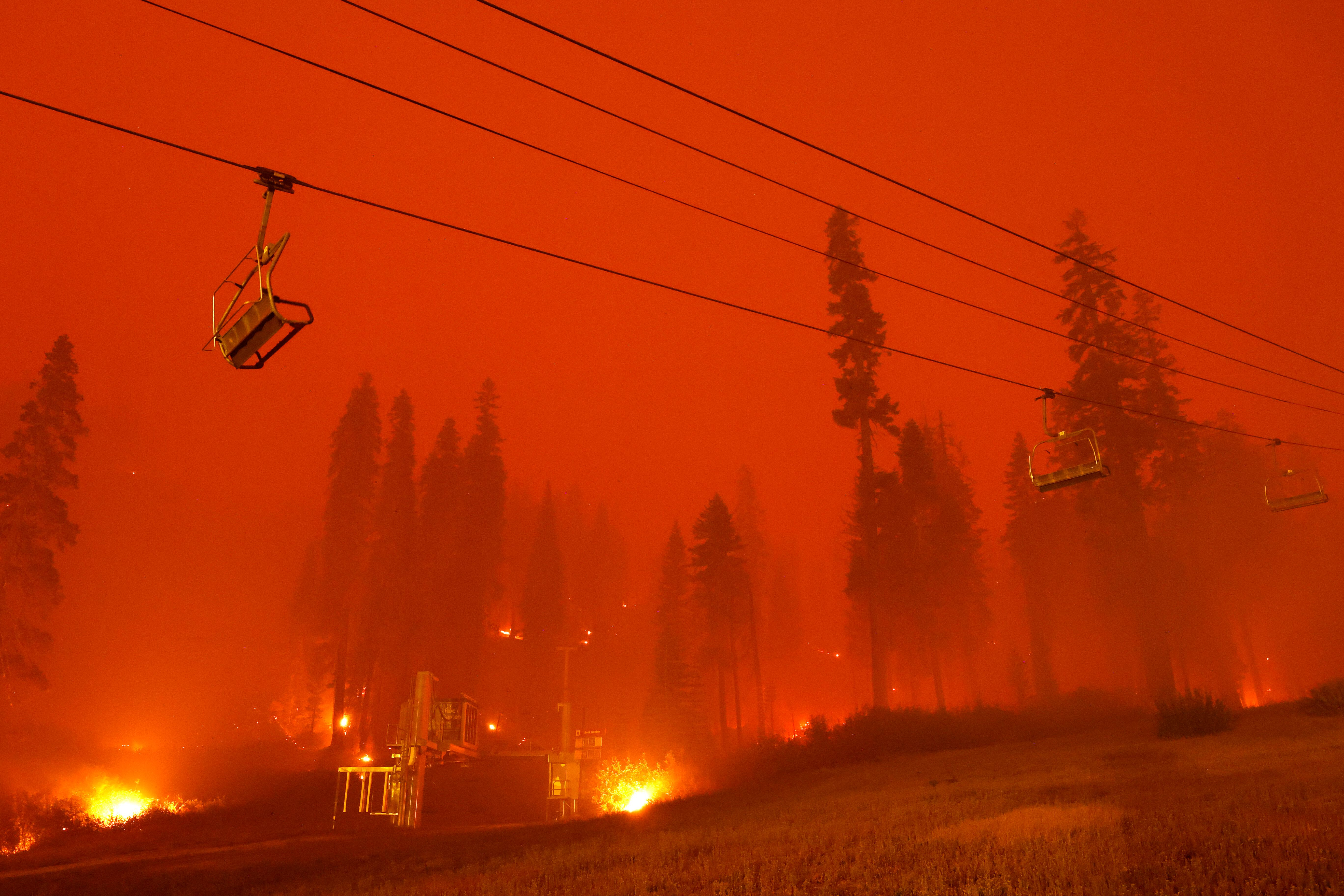 A chairlift at Sierra-at-Tahoe ski resort sits idle Monday as the Caldor fire moves through the Twin Bridges, California, are
