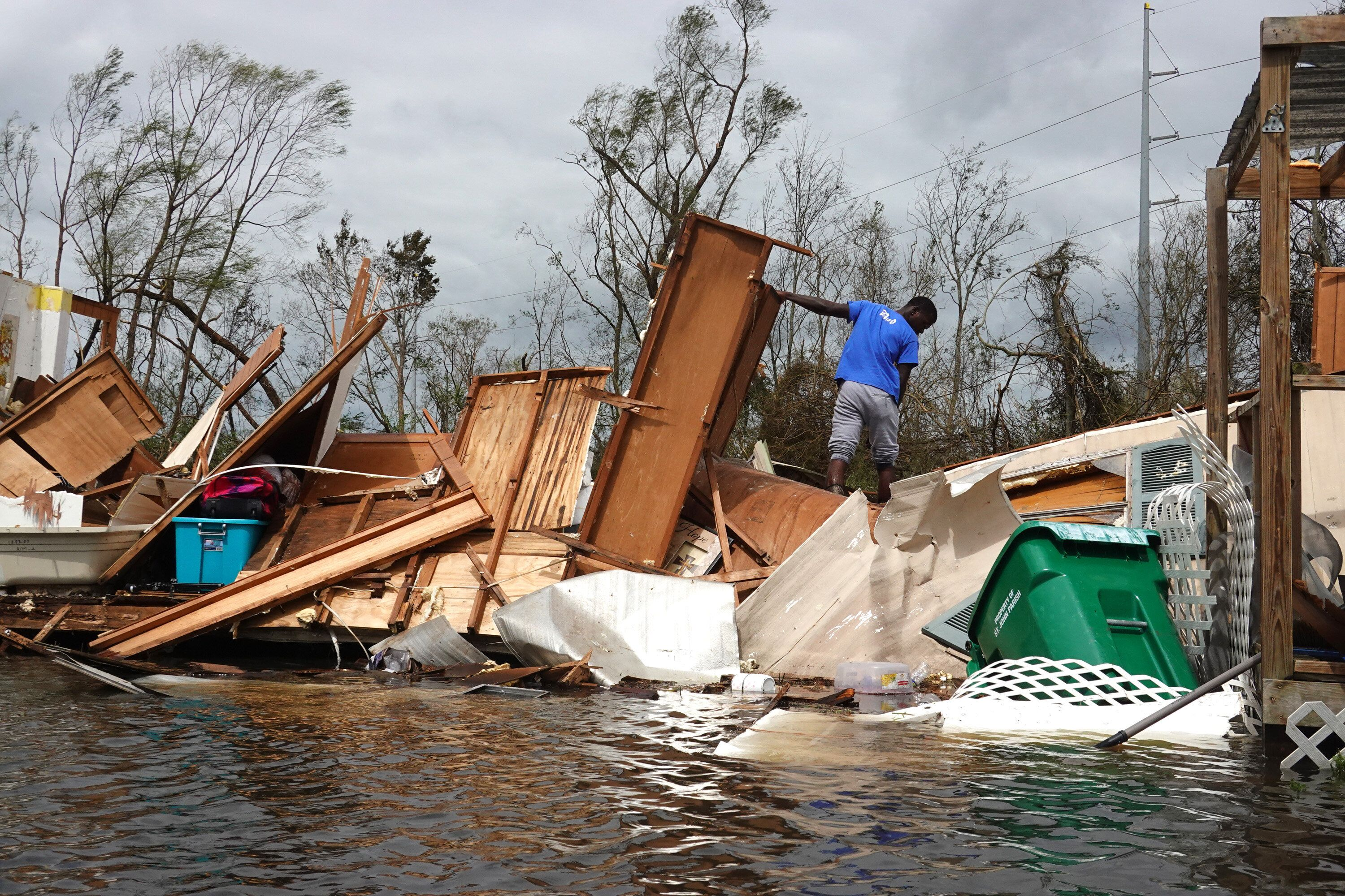 Alonzo Lewis rescues items from his mother's home after it was destroyed by Hurricane Ida on Aug. 30, 2021, in Laplace, Louis