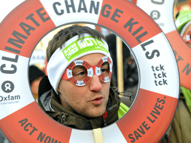 One of some of 30,000 people demonstrates on December 12, 2009 in the center of Copenhagen to turn up the heat on world leaders debating global warming at the UN climate conference. Some 300 youths shrouded in black threw bricks and smashed windows during the demonstration, prompting swift arrests as some 50 policemen in riot gear intervened. AFP PHOTO / ATTILA KISBENEDEK (Photo credit should read ATTILA KISBENEDEK/AFP/Getty Images)
