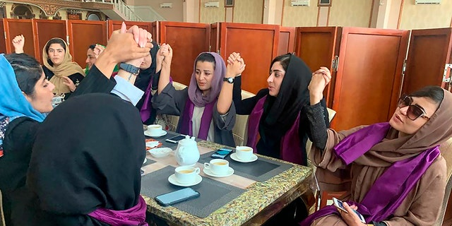 Women gather to demand their rights under the Taliban rule during a protest in Kabul, Afghanistan, Saturday, Sept. 4, 2021. The Taliban have promised an inclusive government and a more moderate form of Islamic rule than when they last ruled the country from 1996 to 2001.