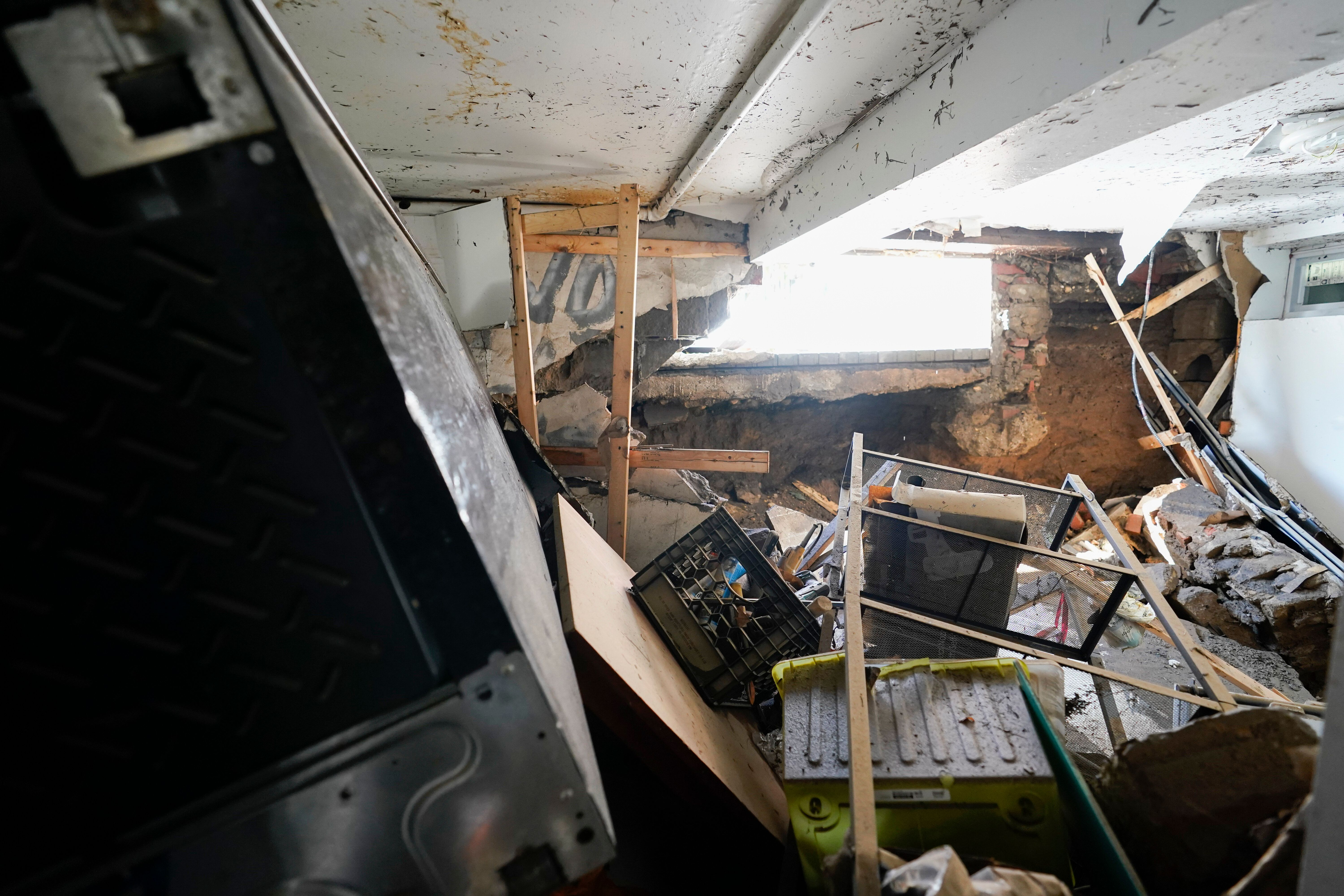 A hole in the foundation where a window once was and flood waters rushed in is seen in the basement apartment on 153rd St. in