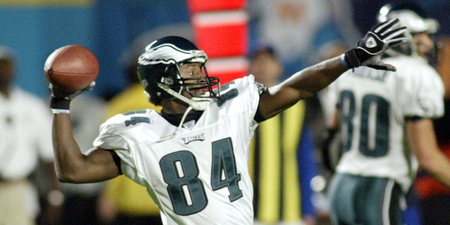 Philadelphia Eagles' wide receiver Freddie Mitchell throws a 26 yard halfback option for a touchdown against the Miami Dolphins in the second quarter in Miami, Florida, December 15, 2003.