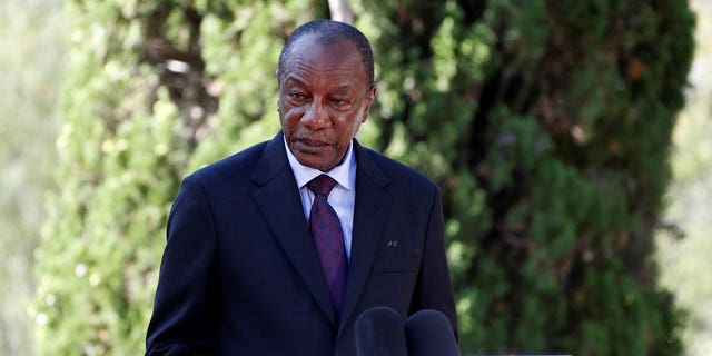 In this Thursday, Aug. 15, 2019 file photo, Guinean President Alpha Conde delivers a speech during a ceremony marking the 75th anniversary of the WWII Allied landings in Provence, in Saint-Raphael, southern France. Witnesses say heavy gunfire has erupted near the presidential palace in Guinea's capital and went on for hours. It was not immediately known whether President Alpha Conde was home at the time the shooting began. But the gunfire prompted security concerns in the West African country with a long history of coup attempts. (Eric Gaillard/Pool Photo via AP, File)