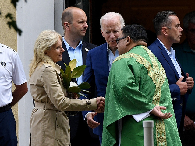 US President Joe Biden (C) and First Lady Jill Biden (L) speaks with a priest as they leave St. Joseph on the Brandywine Catholic Church in Wilmington, Delaware, June 19, 2021. - US Roman Catholic bishops issued a challenge on June 18 to President Biden over his support for abortion rights, agreeing to draft a statement on the meaning of holy communion which could potentially be used to deny the sacred rite to the US leader. (Photo by Olivier DOULIERY / AFP) (Photo by OLIVIER DOULIERY/AFP via Getty Images)