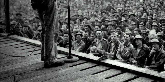 """Actor Gary Cooper thrills Marines at a Southwest Pacific base by repeating the famous farewell speech he gave as Lou Gehrig in the movie """"Pride of the Yankees."""" Cooper headed a camp show, which toured the Pacific islands, circa 1942."""
