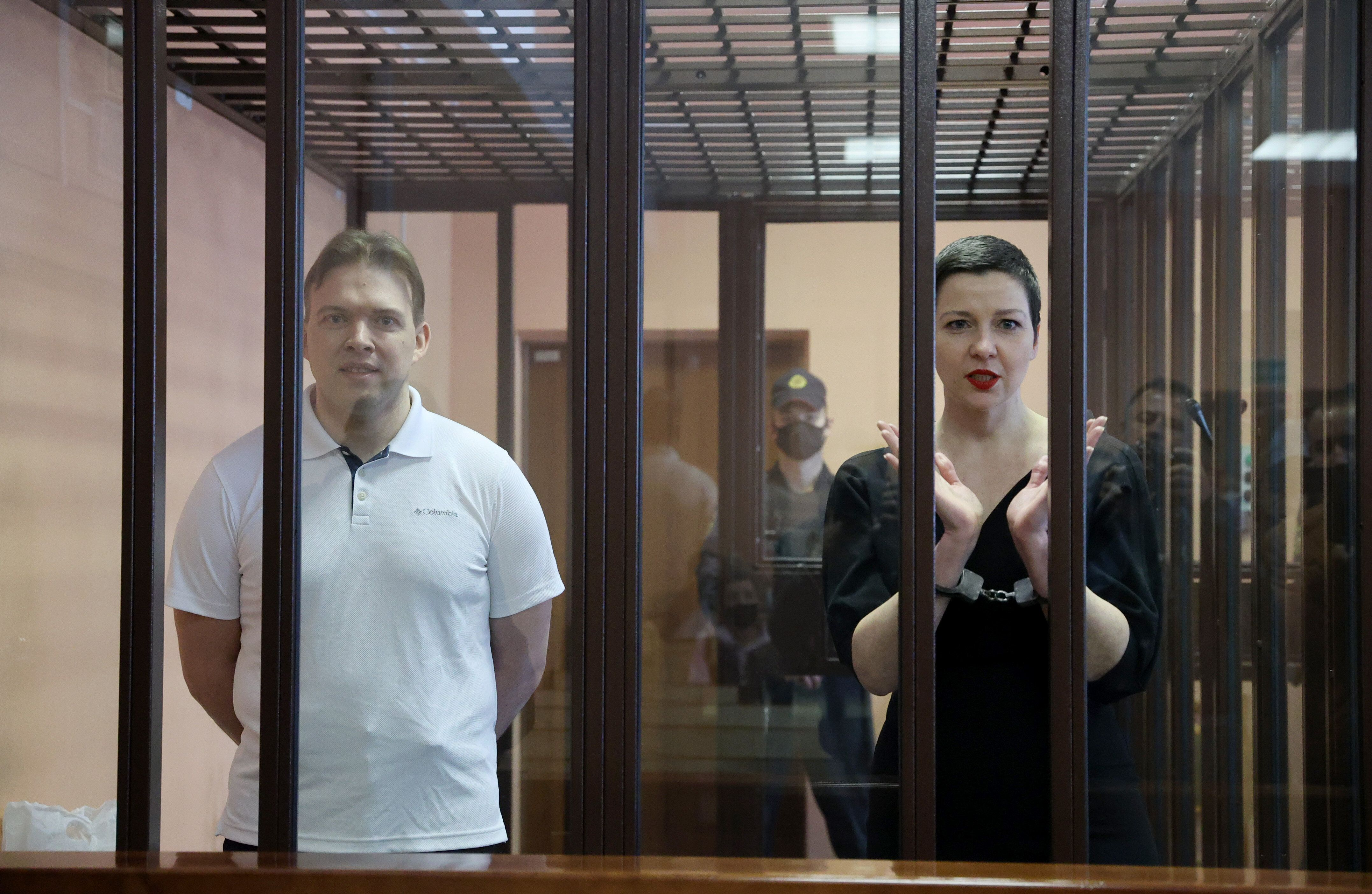 Belarusian opposition activists Maxim Znak, left, and Maria Kolesnikova appear for a sentencing hearing at the Minsk Region C