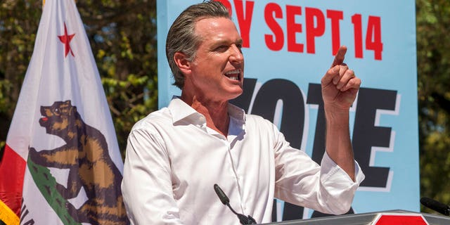 California Democratic Gov. Gavin Newsom campaigns against the California recall election at the Culver City High School in Culver City, Calif., Saturday, Sept. 4, 2021. Newsom enlisted progressive star Sen. Elizabeth Warren, D-Mass., on Saturday to help him overcome a looming recall election that could remove him from office. (AP Photo/Damian Dovarganes)