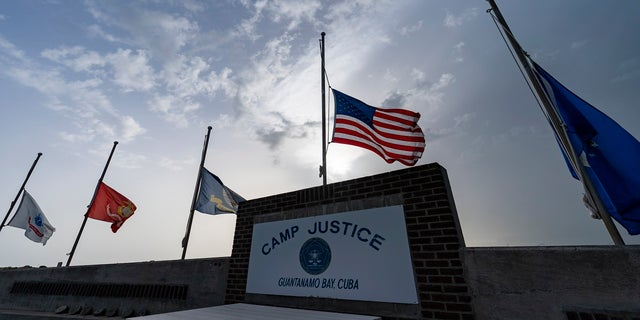 Flags fly at half-staff in honor of the U.S. service members and other victims killed in the terrorist attack in Kabul, Afghanistan, at Camp Justice on Aug. 29 in Guantanamo Bay Naval Base, Cuba.