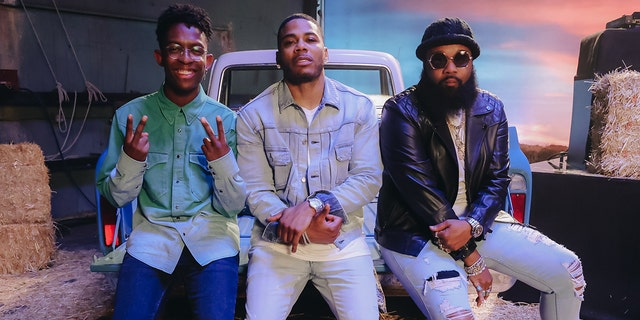 Breland, Nelly and Blanco Brown perform on the set of their new single music video shoot with Breland and Blanco Brown on July 19, 2021 in Los Angeles, Calif.
