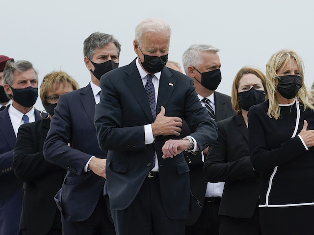 President Joe Biden, first lady Jill Biden and others attend a casualty return as a carry team finishes placing a transfer case containing the remains of Marine Corps Lance Cpl. Jared M. Schmitz, 20, of St. Charles, Mo., into the transfer vehicle Sunday, Aug. 29, 2021, at Dover Air Force Base, Del. According to the Department of Defense, Schmitz a died in an attack at Afghanistan's Kabul airport, along with 12 other U.S. service members. (AP Photo/Carolyn Kaster)