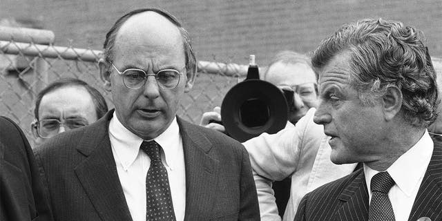 FILE - In this Oct. 14, 1982, file photo, Illinois Democratic gubernatorial candidate Adlai Stevenson III, left, talks with Sen. Edward Kennedy, right, talk as they finish a series of appearances in Chicago. Stevenson III, of Illinois, has died at his home on Chicago's North Side. He was 90. On Tuesday, Sept. 7, 2021, his son Adlai Stevenson IV confirmed the Democrat's death and said his father had dementia. (AP Photo/File)