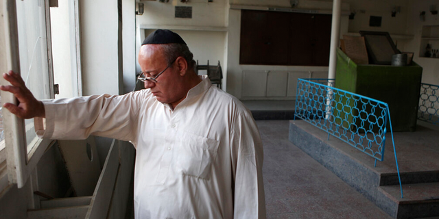 FILE: Zebulon Simentov, the last known Jew living in Afghanistan, closes the window to the synagogue he cares for in his Kabul home.