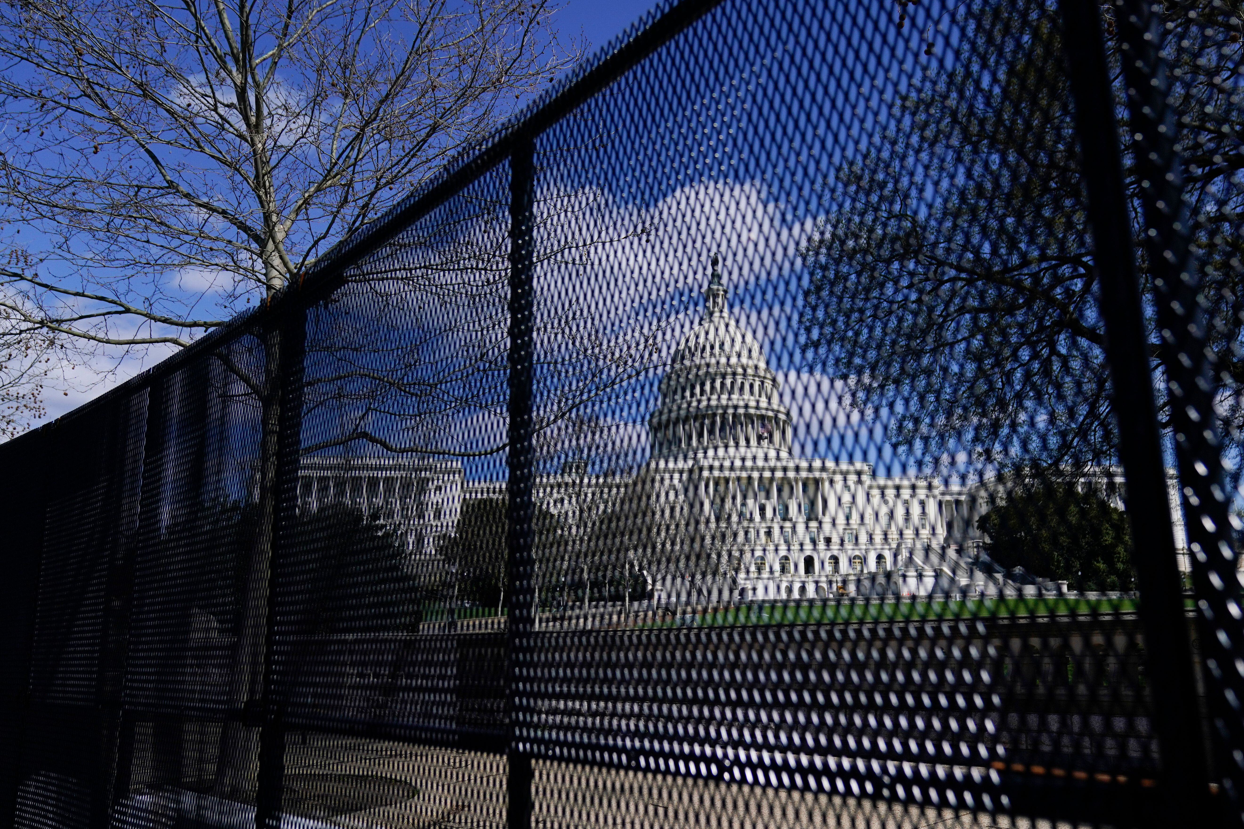 In this April 2, 2021, file photo, the U.S. Capitol is seen behind security fencing on Capitol Hill in Washington. Law enforc