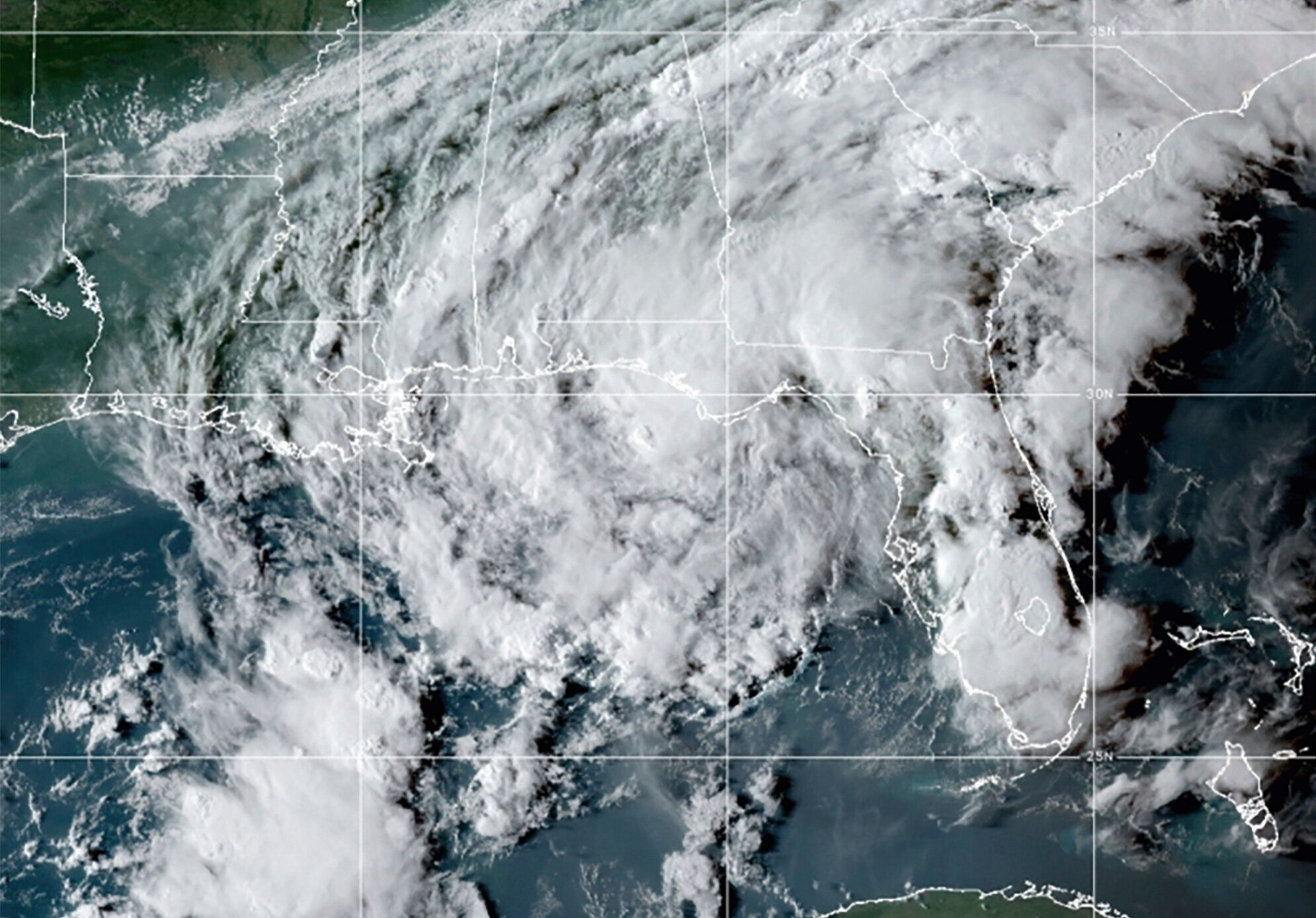 This GOES- East GeoColor satellite image taken Wednesday at 10:30 p.m. EDT. shows Tropical Storm Mindy as it makes landfall o