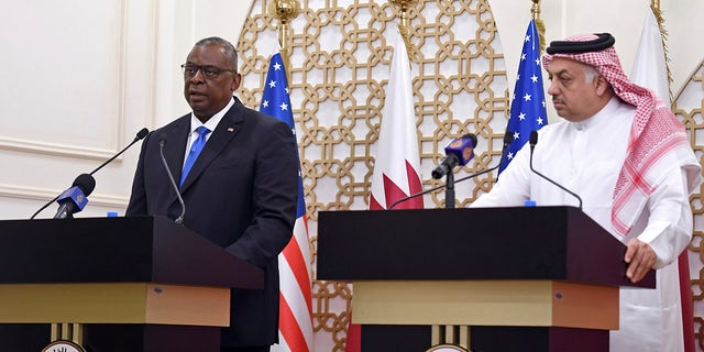 US Secretary of Defense Lloyd Austin speaks during a joint press conference with US Secretary of State Antony Blinken, Qatari Deputy Prime Minister and Foreign Minister Mohammed bin Abdulrahman al-Thani, and Qatari Defense Minister Khalid Bin Mohammed Al-Attiyah, right, at the Ministry of Foreign Affairs in Doha, Qatar, Tuesday, Sept. 7, 2021. (Olivier Douliery/Pool Photo via AP)