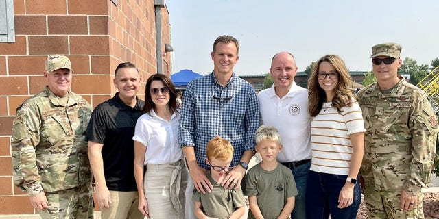 Rep. Moore with his boys, Utah's governor and first lady, Utah's lieutenant governor and second gentleman, and service members at Utah's military family day celebration earlier this summer.