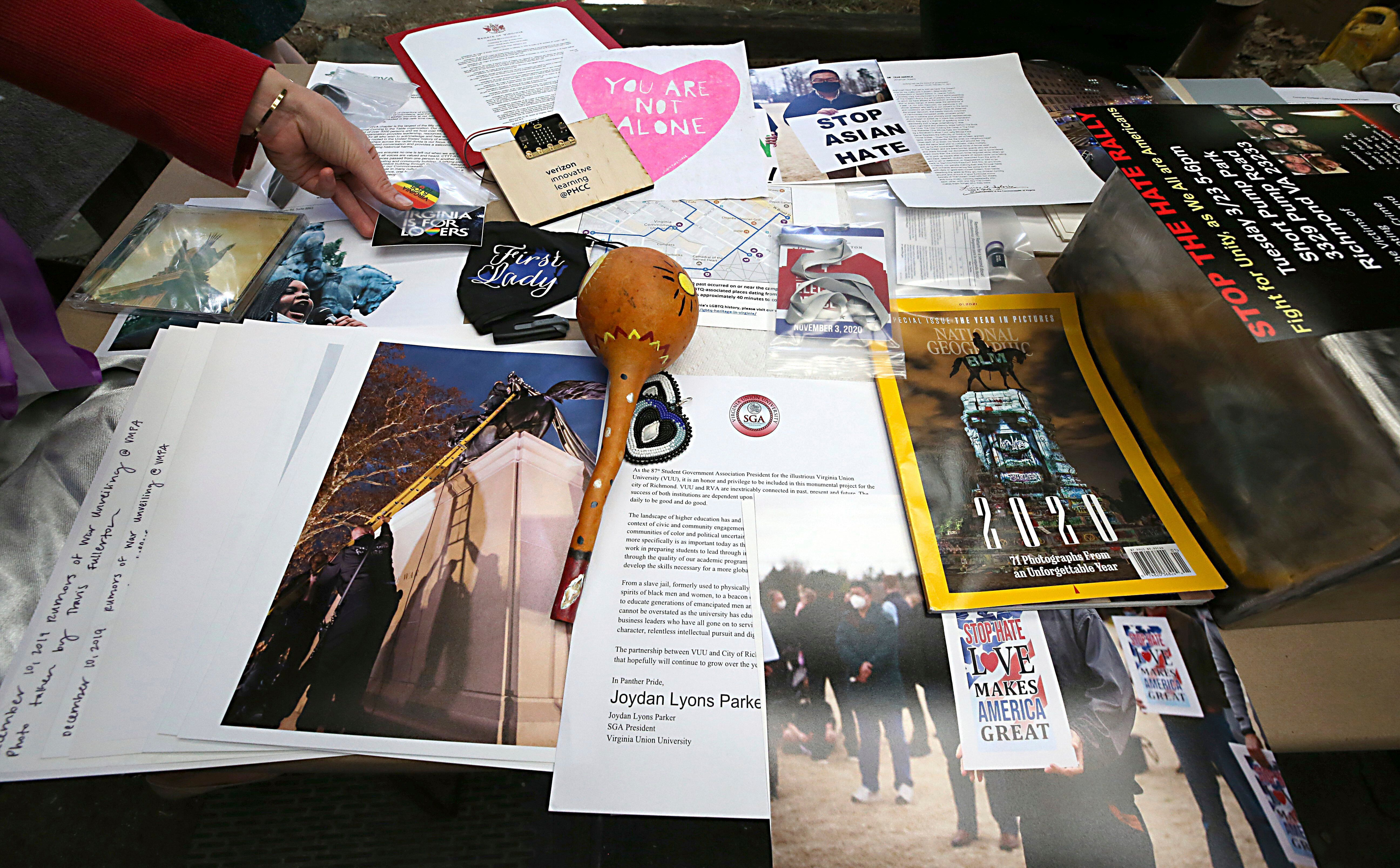 Some of the 39 items placed inside a time capsule that will replace one believed to be in the base of the Robert E. Lee statu
