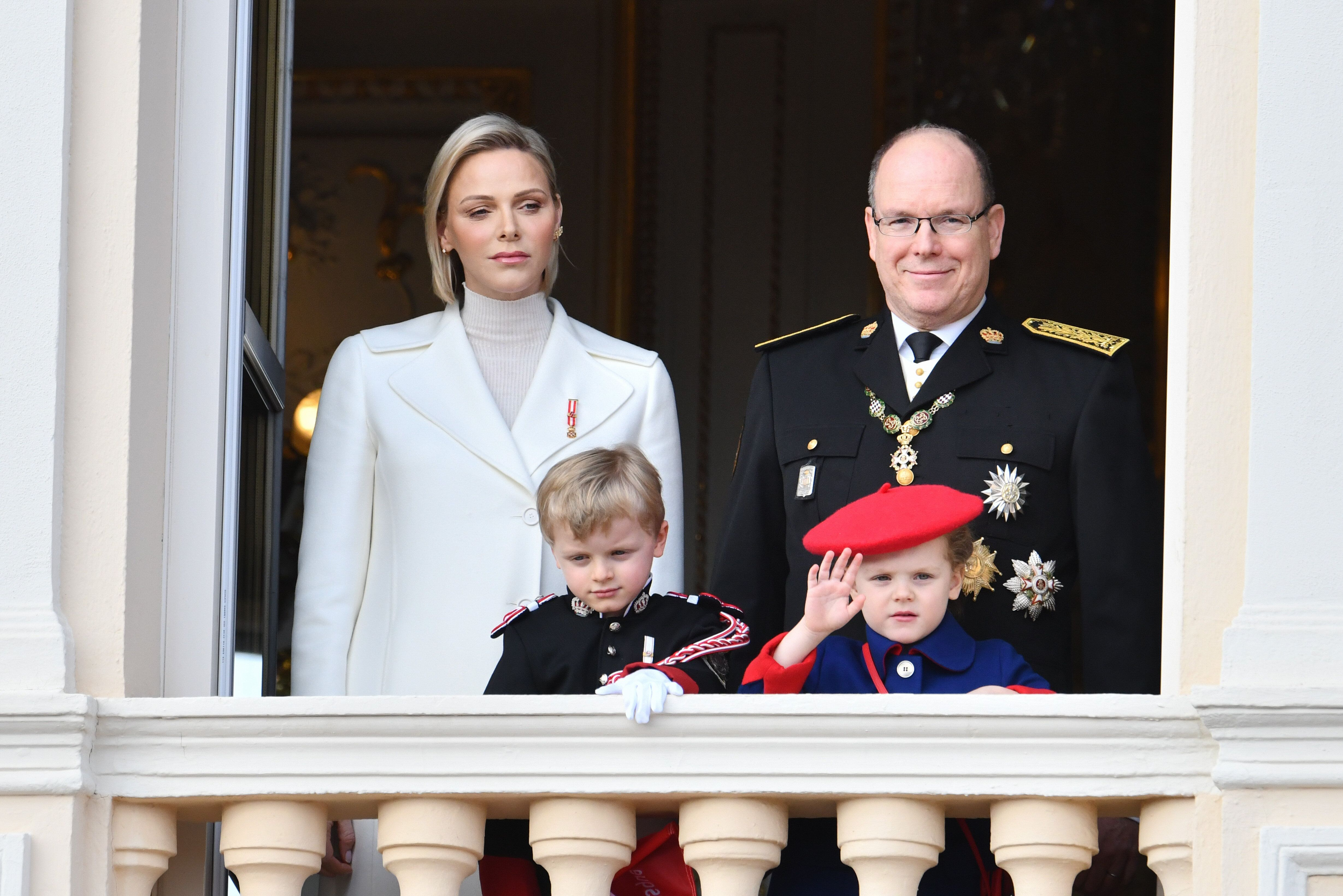 Princess Charlene and Prince Albert II of Monaco, with children Jacques and Gabriella, pose on the palace balcony during the
