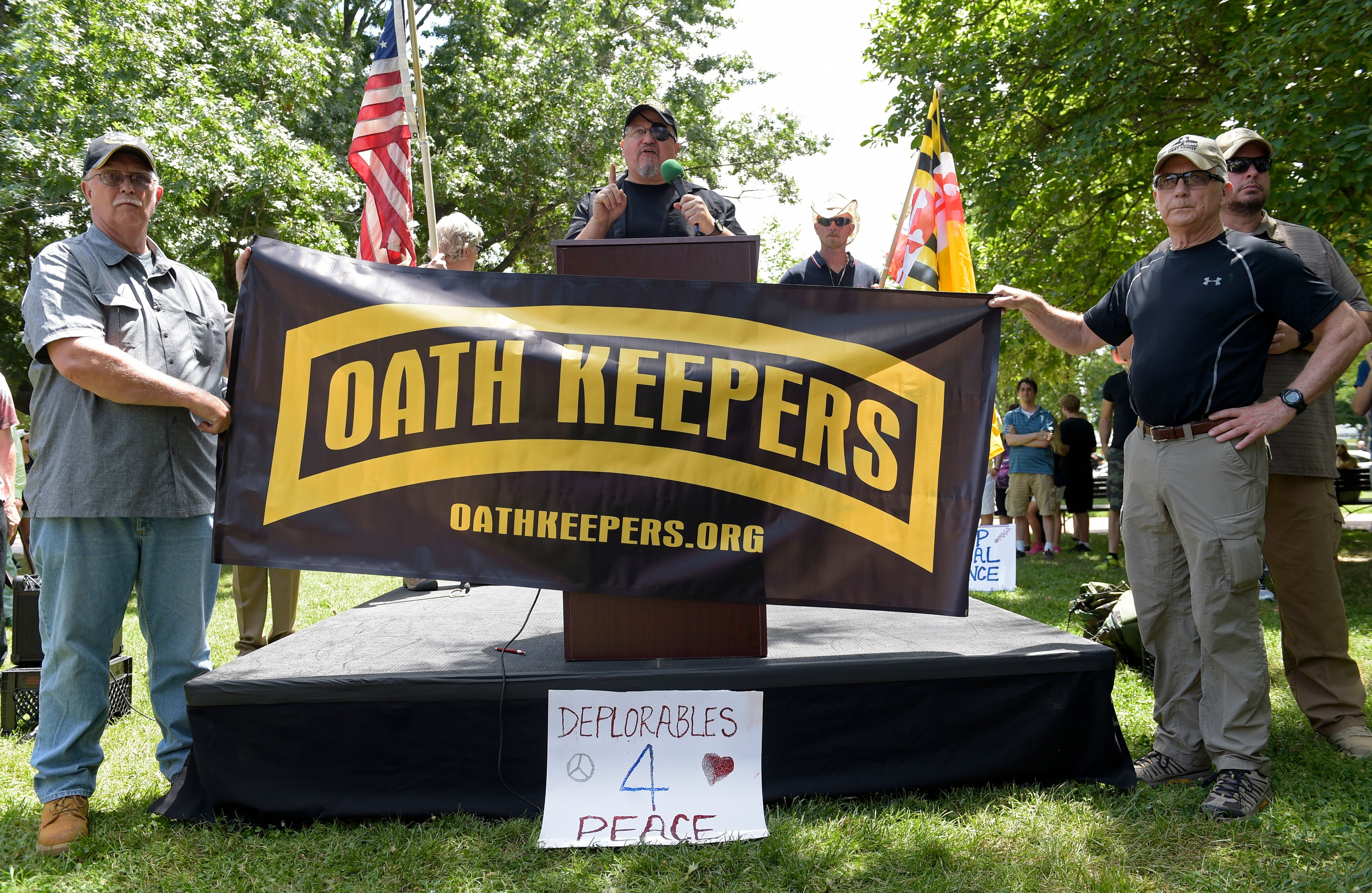 """Stewart Rhodes, founder of the citizen militia group known as the Oath Keepers, center, speaks during a """"rally against politi"""