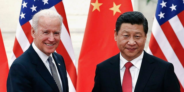 Then-Vice President Joe Biden meets with Chinese President Xi Jinping inside the Great Hall of the People in Beijing, Dec. 4, 2013. (Reuters)