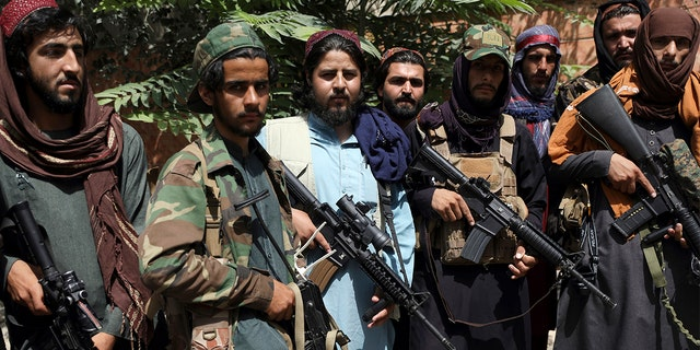 Taliban fighters pose for photograph in Kabul on Aug. 18, 2021. (AP Photo/Rahmat Gul)