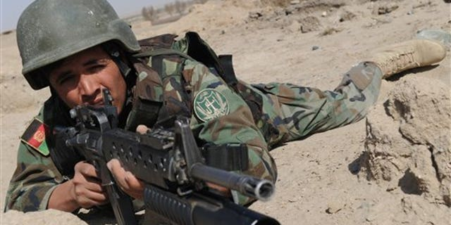An Afghan National Army soldier alert during an exercise near a military base. (AP Photo)