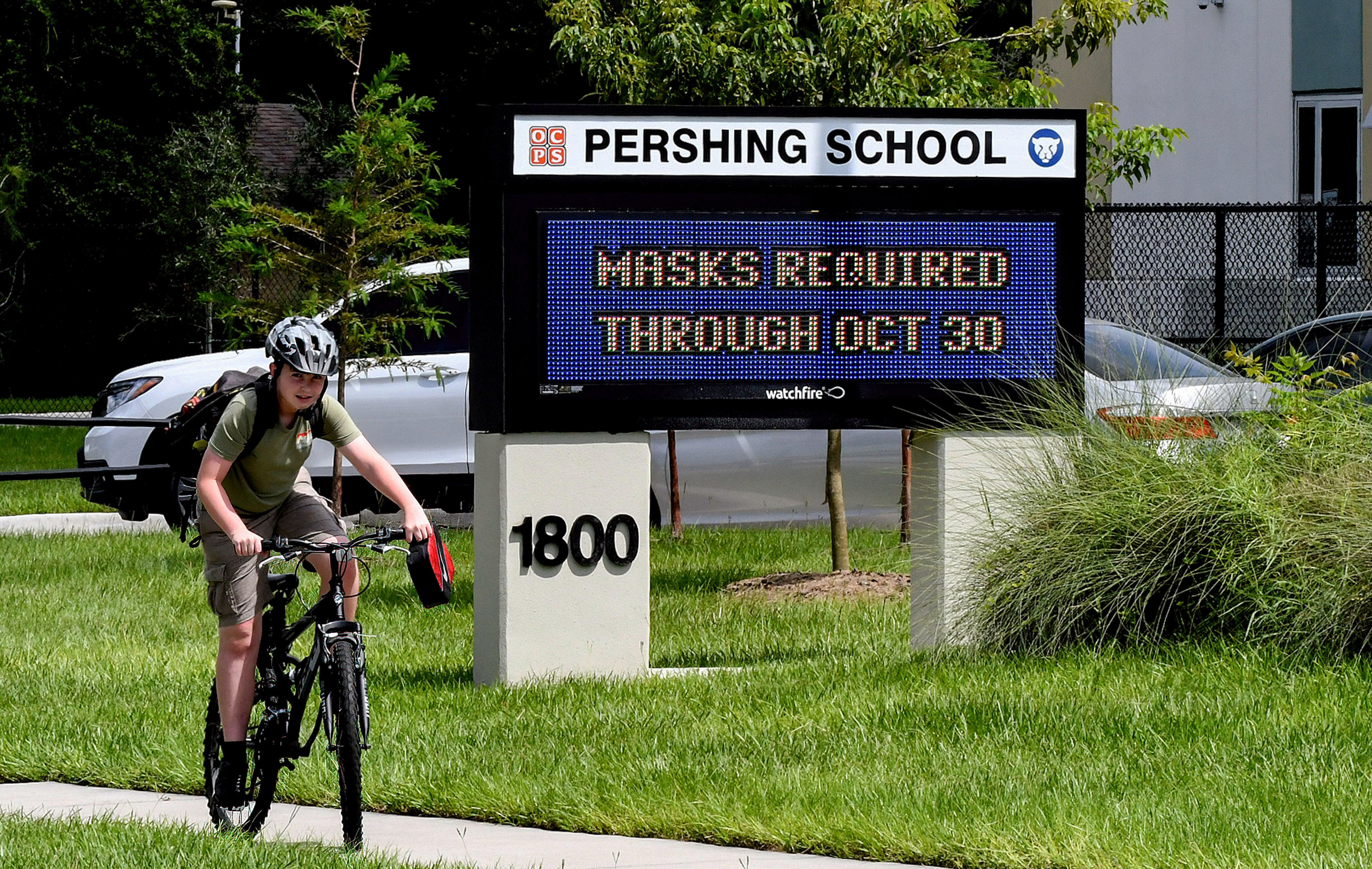 A sign at Pershing School in Orlando advises that face masks are required for students through Oct. 30. On Aug. 27, a Florida