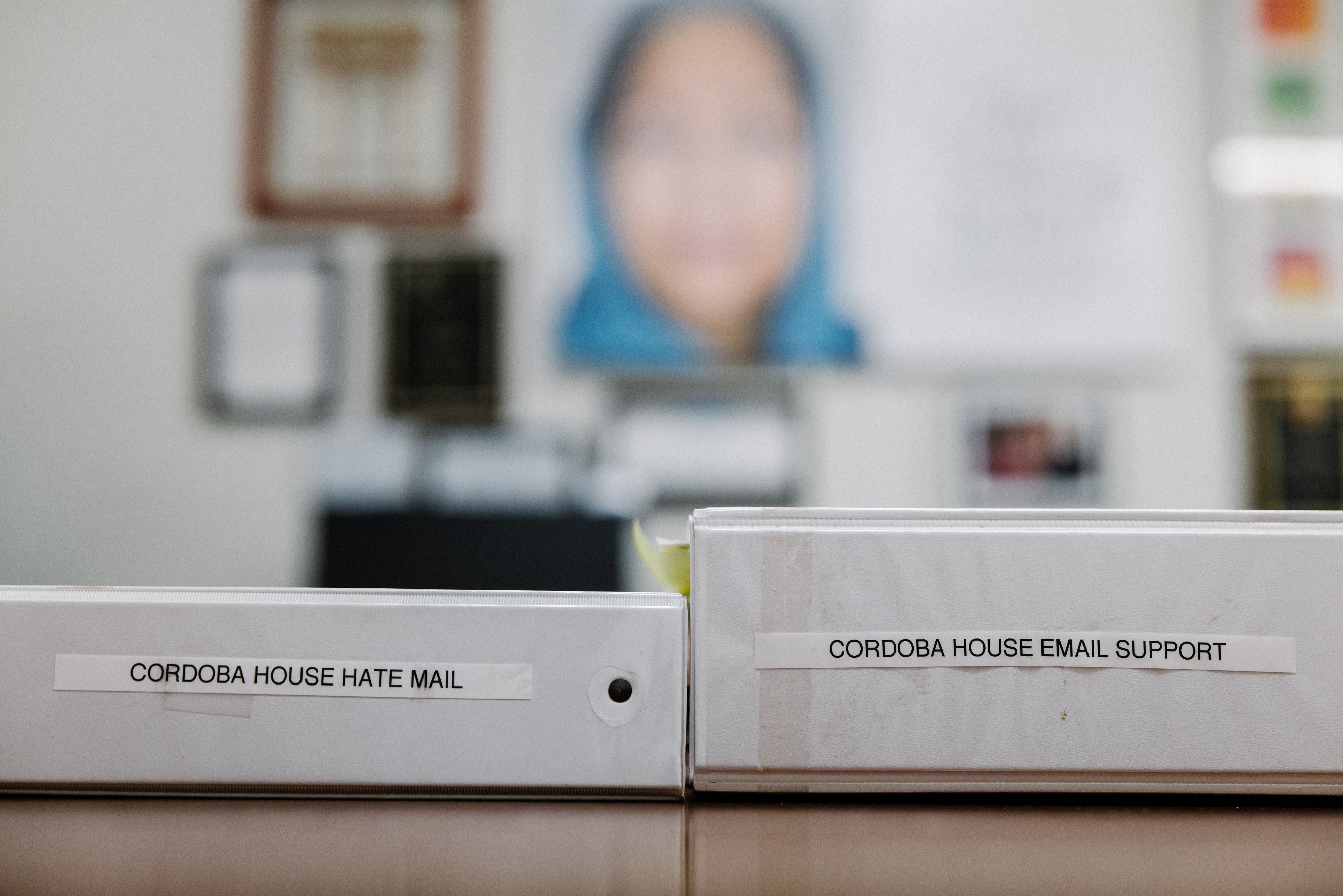 Binders of both hate mail and support letters in Daisy Khan's office.
