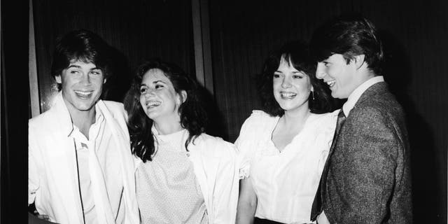 L-R: Actors Rob Lowe, Melissa Gilbert, Michelle Meyrink, and Tom Cruise smile while attending a screening of the film 'In The Custody of Strangers' at the Samuel Goldwyn Theatre, Beverly Hills, California, April 22, 1982.