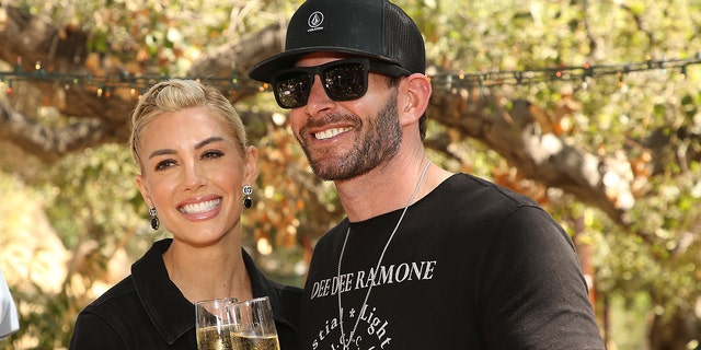 Heather Rae Young and Tarek El Moussa attend the PETA hosts bridal shower for longtime animal rights activist held at Kindred Spirits Care Farm on September 02, 2021, in Chatsworth, Calif.