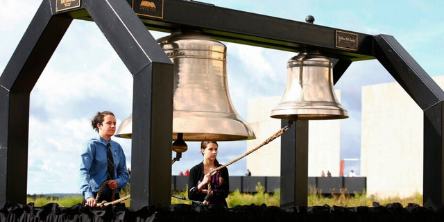 FILE - Matthew Prosser and Gina Rhoads of Shanksville-Stonycreek High School ring the Bells of Remembrance during the service of remembrance tribute to the passengers and crew of Flight 93 at the Flight 93 National Memorial in Shanksville, Pa, Sunday, Sept. 11, 2016, as the nation marks the 15th anniversary of the Sept. 11 attacks.