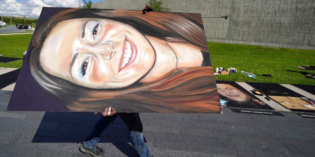 A chalk portrait of Deora Frances Bodley, from San Diego, is carried along the flight path leading to the Flight 93 National Memorial on Thursday, Sept. 9, 2021, in Shanksville, Pa., as the nation prepares to mark the 20th anniversary of the Sept. 11, 2001 attacks, Saturday, Sept. 11, 2021. 40 chalk portraits of the passengers and crew of Flight 93, were created by 11 chalk artists from around the country over two days.
