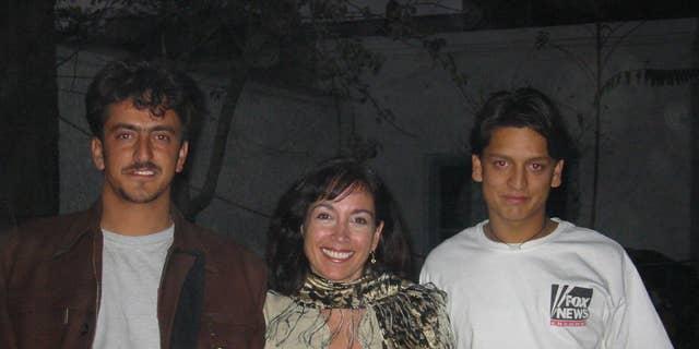 Khorshied Nusratty in Afghanistan. From left to right Massood Sanjer, Khorshied Nusratty, Mustafa Sanjer at FOX News House,,Kabul, 2002