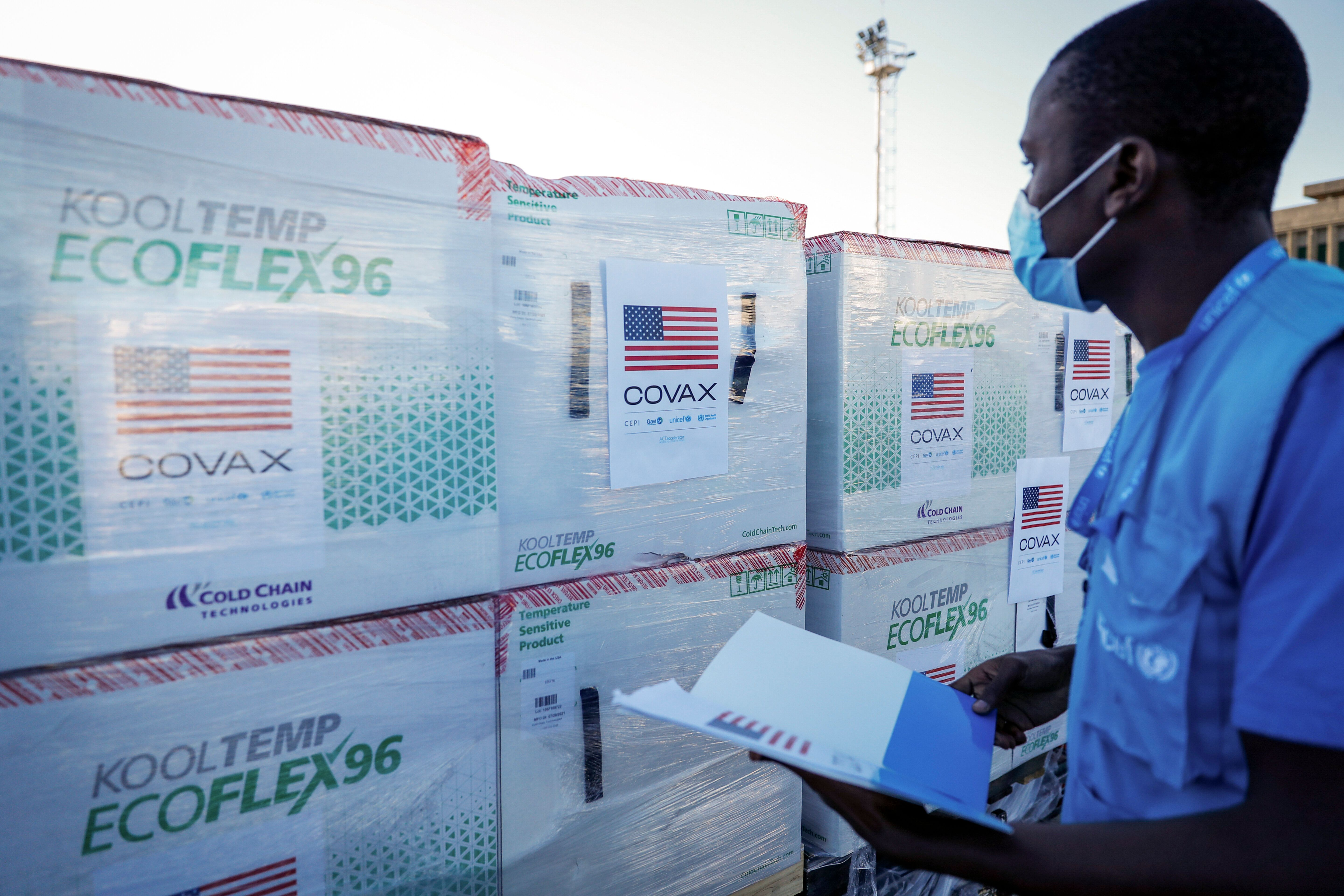 A UNICEF worker checks boxes of Moderna coronavirus vaccine after their arrival in Nairobi on Aug. 23 — the first time