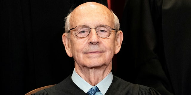 FILE PHOTO: Associate Justice Stephen Breyer poses during a group photo of the Justices at the Supreme Court in Washington, April 23, 2021. Erin Schaff/Pool via REUTERS/File Photo