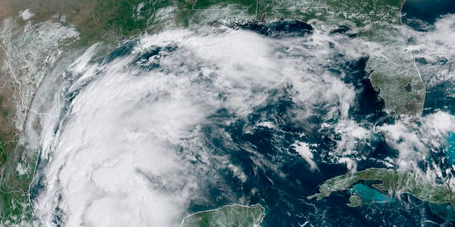 This satellite image provided by NOAA shows Tropical Storm Nicholas in the Gulf of Mexico on Sunday, Sept. 12, 2021. (NOAA via AP)