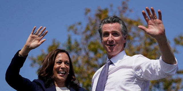 Vice President Kamala Harris stands on stage with California Gov. Gavin Newsom at the conclusion of a campaign event at the IBEW-NECA Joint Apprenticeship Training Center in San Leandro, Calif., Wednesday, Sept. 8, 2021. (AP Photo/Carolyn Kaster)