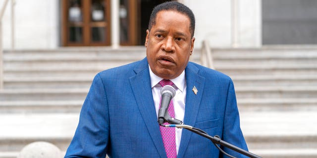 Conservative radio talk show host Larry Elder speaks to supporters during a campaign stop outside the Hall of Justice downtown Los Angeles, Thursday, Sept. 2, 2021. Elder is running to replace Democratic Gov. Gavin Newsom in the Sept. 14 recall election. (AP Photo/Damian Dovarganes)