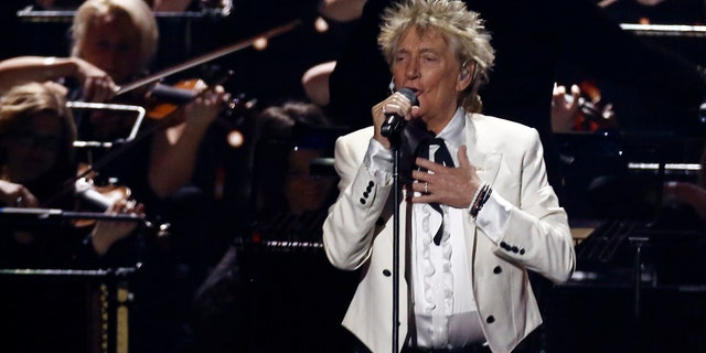 """In this Feb. 18, 2020 file photo, Rod Stewart performs on stage at the Brit Awards 2020 in London. A Florida judge on Thursday, Sept. 9, 2021, has canceled the trial for Stewart and his adult son and scheduled a hearing next month to discuss a plea deal to resolve misdemeanor charges. The singer of 70s hits such as """"Da Ya Think I'm Sexy?"""" and """"Maggie May"""" and his son are accused of pushing and shoving a security guard at an upscale hotel because he wouldn't let them into a New Year's Eve party nearly two years ago."""