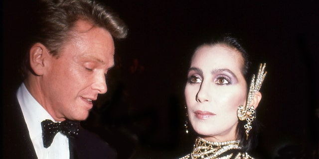 Designer Bob Mackie and the singer and actress Cher attend the Costume Institute Gala at the Metropolitan Museum of Art, New York, New York, 1985.
