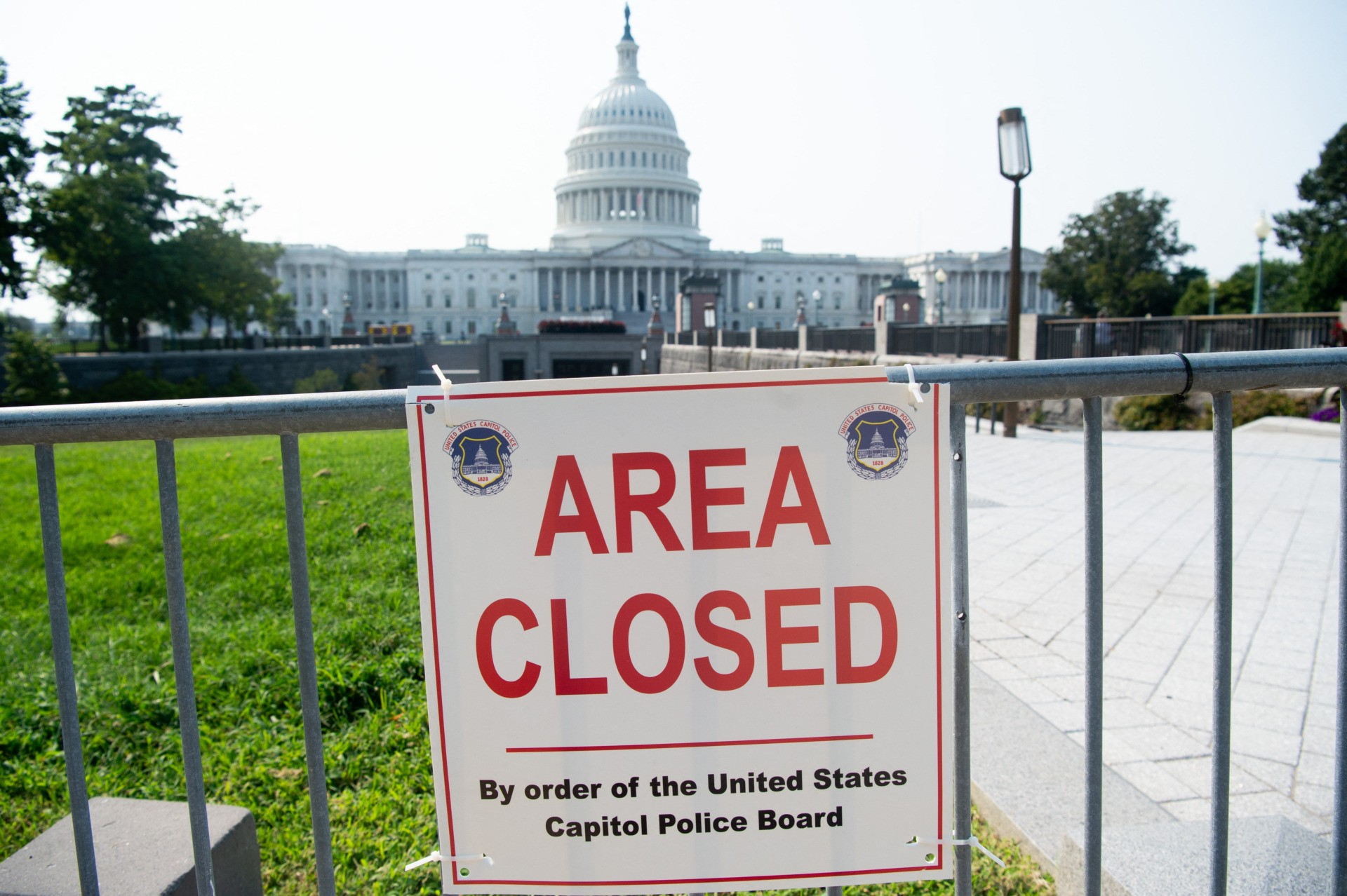 """An """"Area Closed"""" sign appears on temporary security fencing outside the US Capitol in Washington, DC, September 13, 2021, as security increases ahead of the planned September 18 rally in support of the January 6 insurrectionists on Capitol Hill. (Photo by SAUL LOEB / AFP) (Photo by SAUL LOEB/AFP via Getty Images)"""