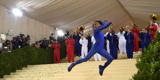"""Nia Dennis and the Brooklyn United marching band attend The Metropolitan Museum of Art's Costume Institute benefit gala celebrating the opening of the """"In America: A Lexicon of Fashion"""" exhibition on Monday, Sept. 13, 2021, in New York."""