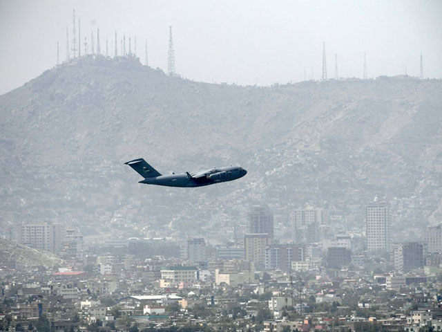 TOPSHOT - An US Air Force aircraft takes off from the airport in Kabul on August 30, 2021. - Rockets were fired at Kabul's airport on August 30 where US troops were racing to complete their withdrawal from Afghanistan and evacuate allies under the threat of Islamic State group attacks. (Photo by Aamir QURESHI / AFP) (Photo by AAMIR QURESHI/AFP via Getty Images)