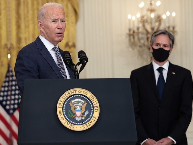 WASHINGTON, DC - AUGUST 20: U.S. President Joe Biden gestures to Secretary of State Antony Blinken as he gives remarks on the U.S. military's ongoing evacuation efforts in Afghanistan from the East Room of the White House on August 20, 2021 in Washington, DC. The White House announced earlier that the U.S. has evacuated almost 14,000 people from Afghanistan since the end of July. (Photo by Anna Moneymaker/Getty Images)
