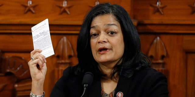 Holding up a copy of the U.S. Constitution, Rep. Pramila Jayapal, D-Wash., votes to approve the second article of impeachment as the House Judiciary Committee holds a public hearing to vote on the two articles of impeachment against former President Trump (Photo by Patrick Semansky-Pool/Getty Images)