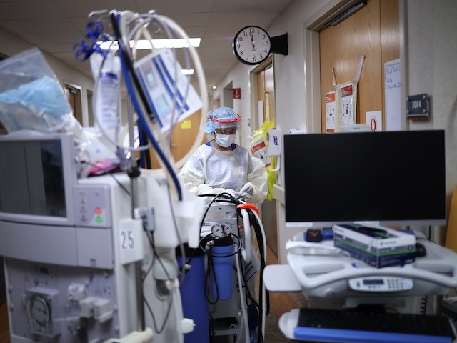 LEONARDTOWN, MARYLAND - MAY 01: (EDITORIAL USE ONLY) A member of the dialysis prepares to treat a patient with coronavirus in the intensive care unit at a hospital on May 1, 2020 in Leonardtown, Maryland. The coronavirus death toll in D.C., Virginia and Maryland surpassed 2,000 people on Friday as the District recorded its largest number of daily infections thus far. (Photo by Win McNamee/Getty Images)
