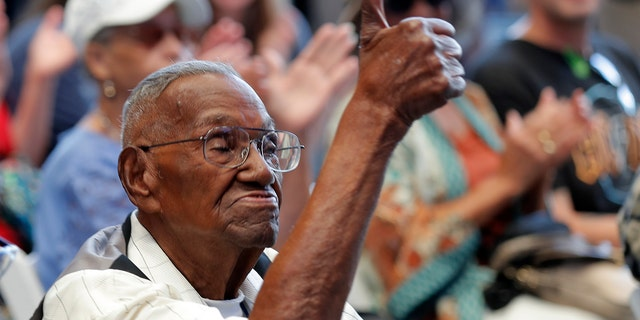 In this Sept. 12, 2019 ,file photo, World War II veteran Lawrence Brooks celebrates his 110th birthday at the National World War II Museum in New Orleans.
