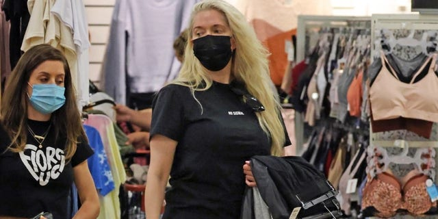 Erika Jayne pictured shopping at TJ Maxx in Pasadena, Calif. The reality TV star was reportedly interrupted periodically by phone calls.