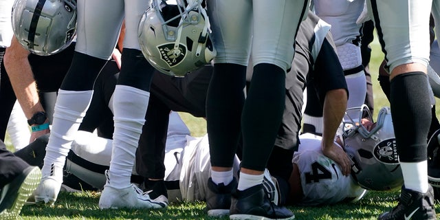 Las Vegas Raiders quarterback Derek Carr (4) is injured on a play during the second half of an NFL football game against the Pittsburgh Steelers in Pittsburgh, Sunday, Sept. 19, 2021. Carr remained in the game.
